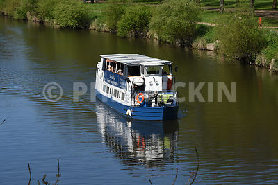 Passengers enjoying a boat trip on the river Severn.