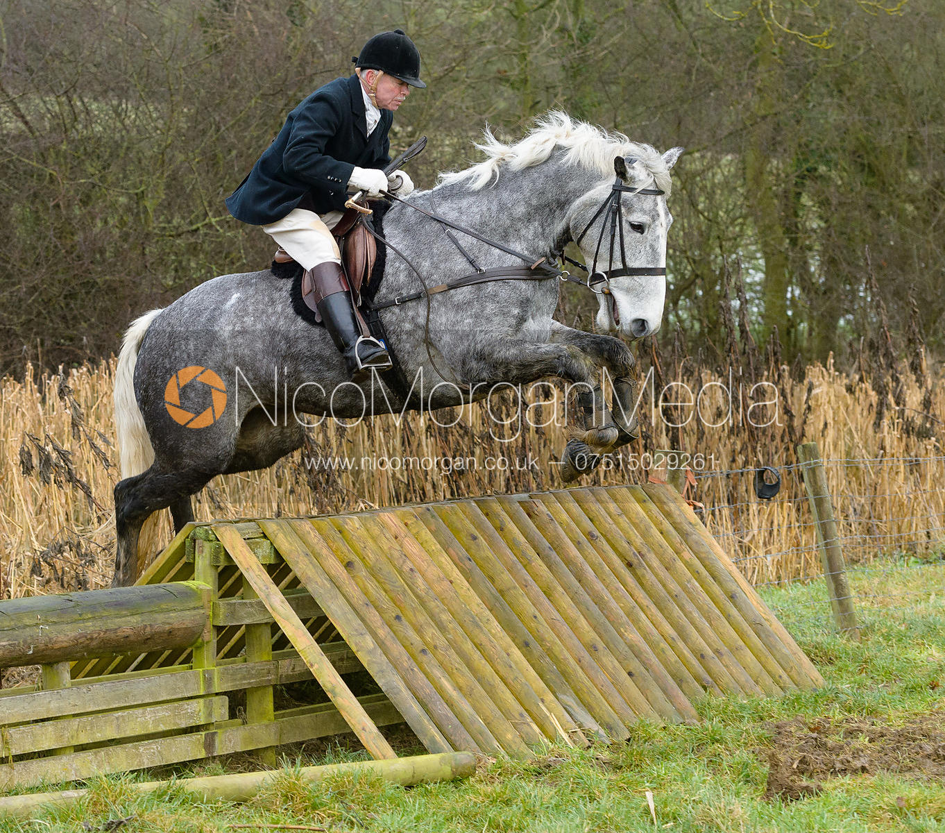 PC jumping a hunt jump at Peakes - The Fitzwilliam Hunt visit the Cottesmore at Burrough House