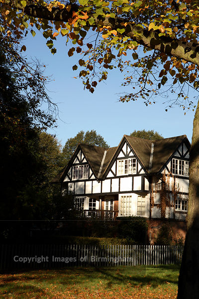 A traditional house along the River Severn in the Quarry Park, Shrewsbury, Shropshire, England. Autumn.