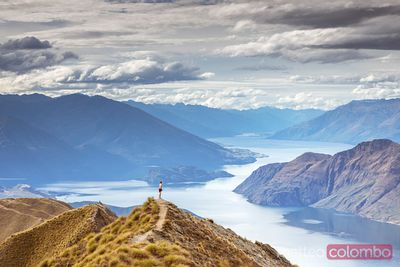 Woman standing at lookout over Wanaka lake, New Zealand