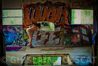Naked girl watching a hole in urbex