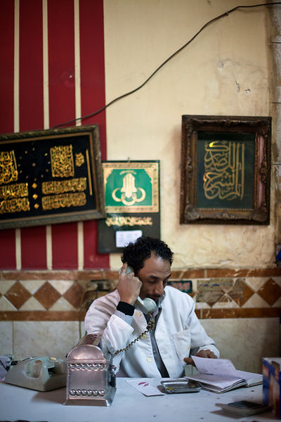 Egypt - Cairo - A waiter takes a telephone call at the Telegraph Cafe, off Halim Square