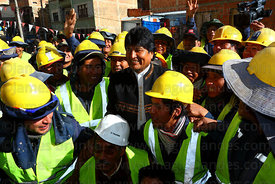President Evo Morales (centre) with Mi Teleferico company workers during opening ceremony of the Yellow Line cable car, La Pa...