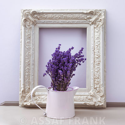 Flower vase with photoframe on table