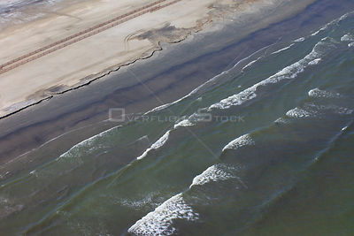 Aerial view of an oil stained beach, contaminated by the BP Deepwater Horizon oil leak in the Gulf of Mexico. Grand Isle, Jef...