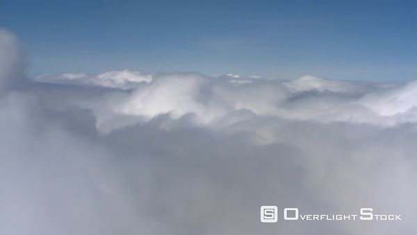 Flying past top of white cloud bank, passenger POV
