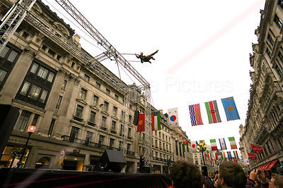 Aerial Performer on Trapeze High above a London Street
