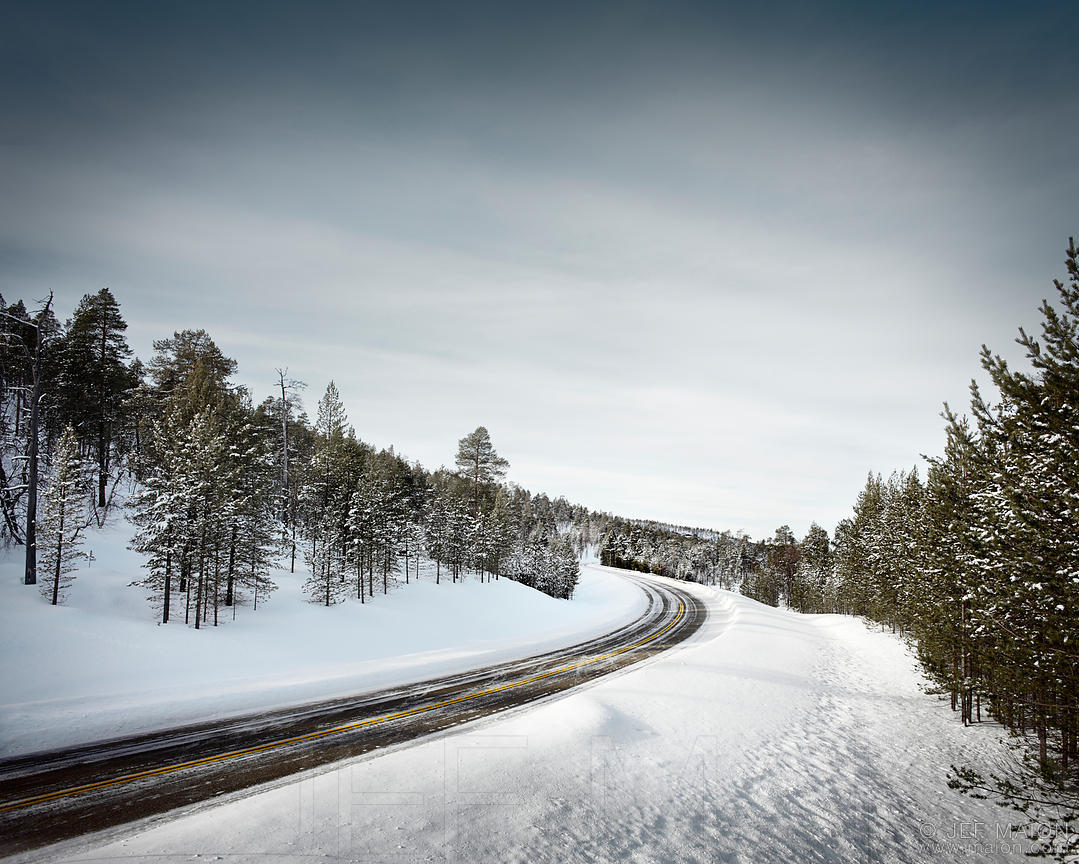 Road curve in winter forest