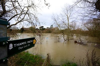 Footpath Sign Pointing to the Thames Path Across Floodwater