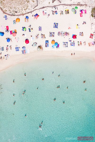 Aerial of Cala Macarelleta beach crowded, Menorca