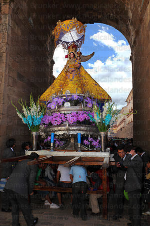 Virgen de los Remedios passing Santa Clara Arch during Corpus Christi festival , Cusco , Peru