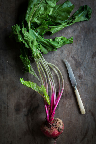 Beetroot on wooden background with knife. Top view