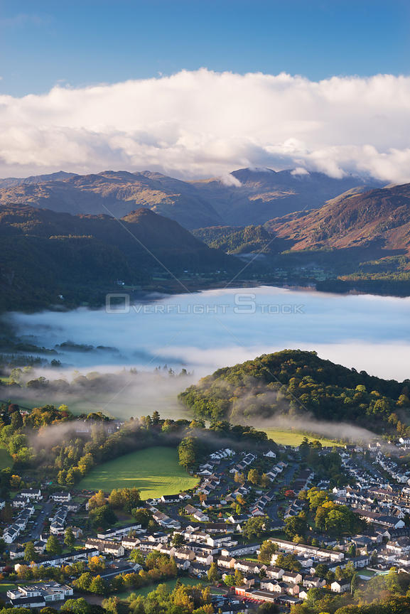 Aerial view over Keswick to a mist covered Derwent Water, Lake District National Park, Cumbria, England. October 2012.