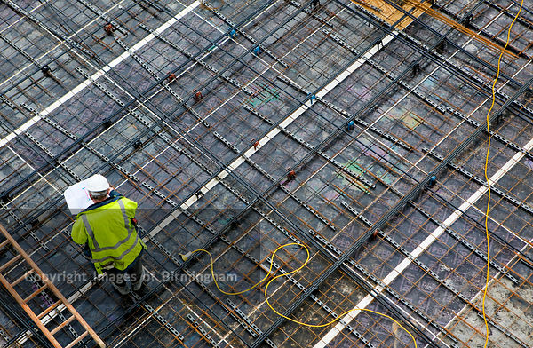 A builder on the roof of a building under construction in Birmingham City Centre.