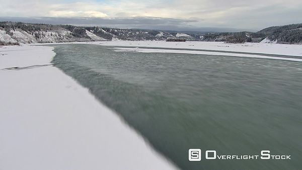 Flying fast and low over icy river in Alaska