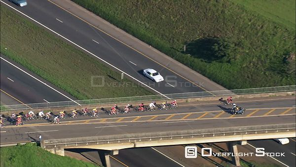 Aerial of cyclists riding over a bridge during a cycle race. kwaZulu Natal South Africa