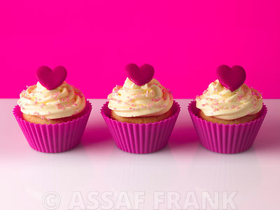 Three cream cupcakes