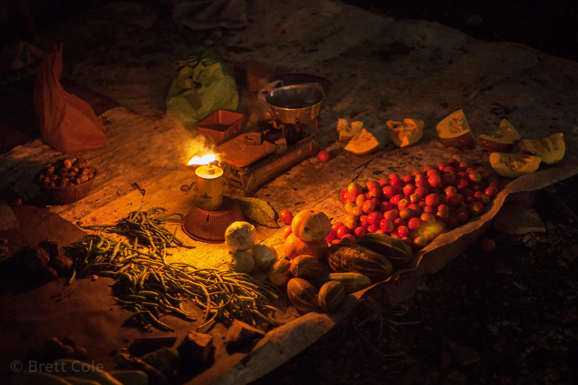 Vegetables for sale at night at a market in the Kokri Agar slum, Mumbai, India.