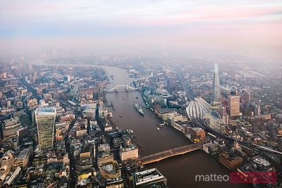 Aerial view of river Thames and the City at dusk, London, UK