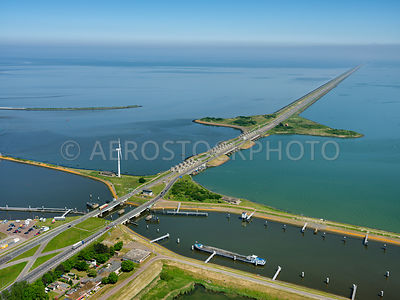 303837| Afsluitdijk (closure Dike) seen from Den Oever with in the foreground the Voorhaven and the Stevinssluizen.
