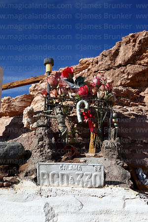 Detail of tributes below monument to Sergio Yánez Ayala and Guillermo Martínez Araya near Calama, Region II, Chile