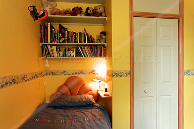 Small Yellow Bedroom with Sloped Ceiling Line and Dormer Window