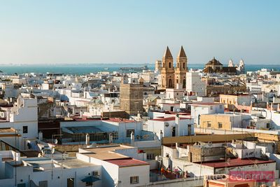 High angle view of city at sunset, Cadiz, Andalusia, Spain