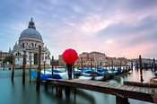 Salute church on the Grand Canal with woman standing, Venice