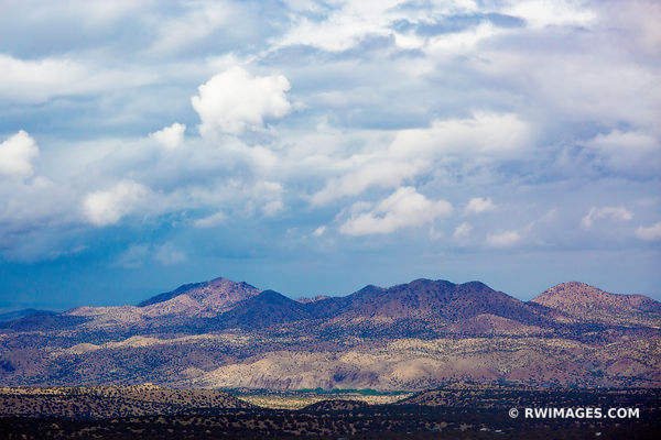 STORMY CLOUDS ENCHANTING LIGHT NORTHERN NEW MEXICO LANDSCAPE COLOR