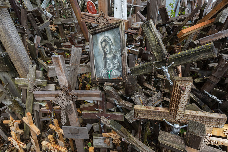 A Framed Madonna is Placed Among the Thousands of Crosses at the Hill of Crosses