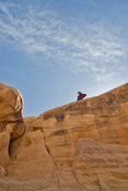 Hiker Atop Rock at Devil's Garden- Grand Staircase Escalante, Utah