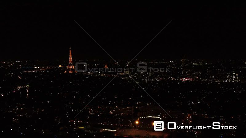 Aerial view of Paris by night seen from helicopter, with Eiffel Tower illuminated, Paris, France