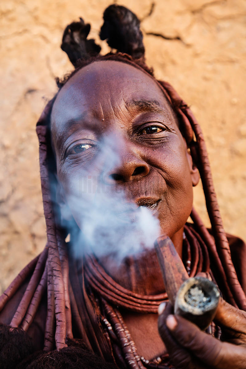 Elderly Himba Woman Smoking a Pipe