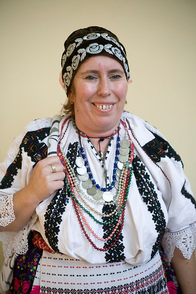 Hungary - Pecs - A woman in traditional costume during a folk event