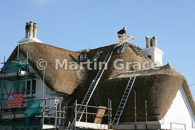 Re-thatching of roof in Sidmouth, south Devon, England