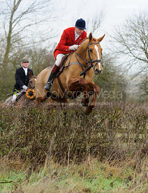 Ashley Bealby jumping a hedge near Mrs Wilson's covert