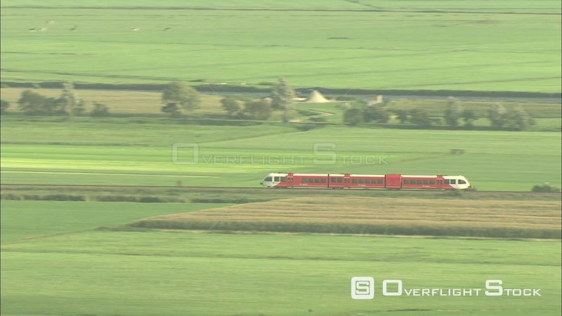 Passenger train rushing through a rural landscape, The Netherlands