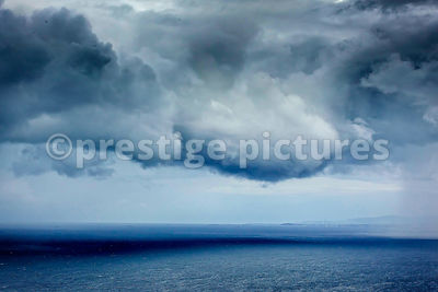Dark Clouds over a Calm Sea