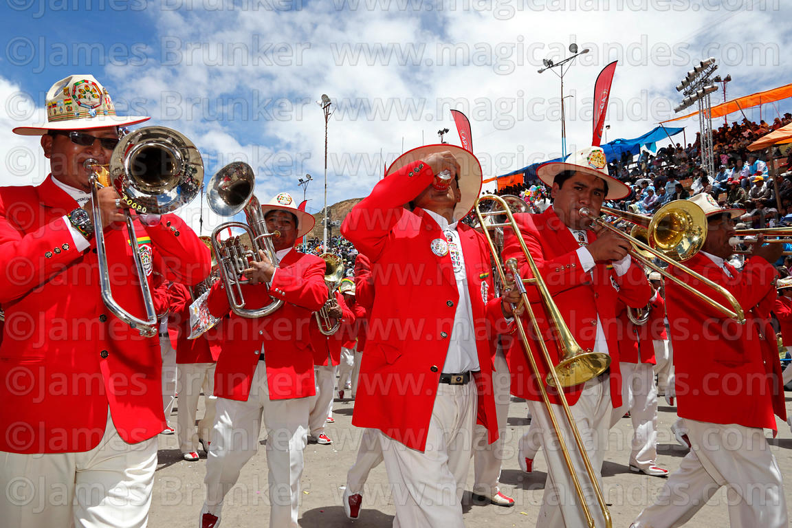 A member of the Poopo brass band drinking beer during parades, Oruro Carnival, Bolivia