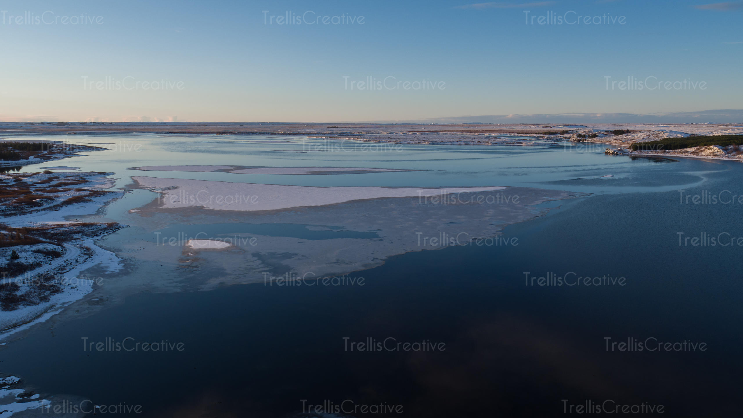 Aerial view of a frozen Iceland lake before sunrise