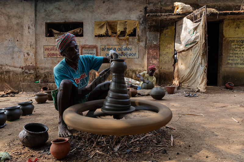 Portrait of a Potter Throwing a Pot on a Traditional Potter's Wheel