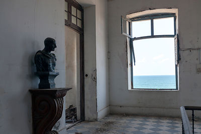 India - Pondicherry - A statue of Gandhi in the derelict Hotel du Ville that has been saved by INTACH (Indian National Trust ...