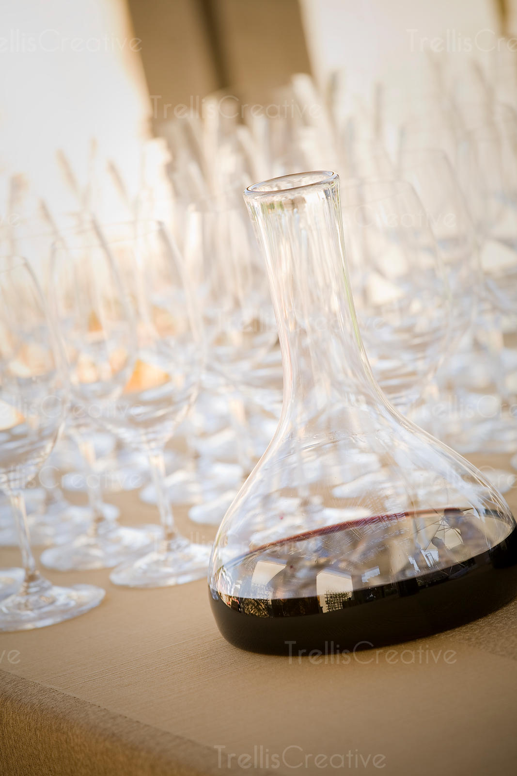 A filled decanter of red wine waiting to be poured