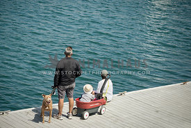 family with dog on dock