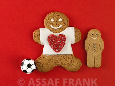 Gingerbread man, a child and a football