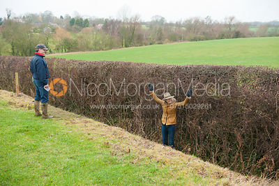 Zoe Gibson in the ditch in front of a hedge