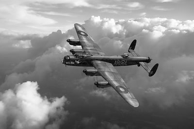 Lancaster W5005 AR-L Leader above clouds BW version
