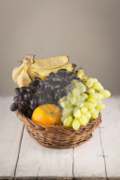 Fruit basket with grape oranges and banans