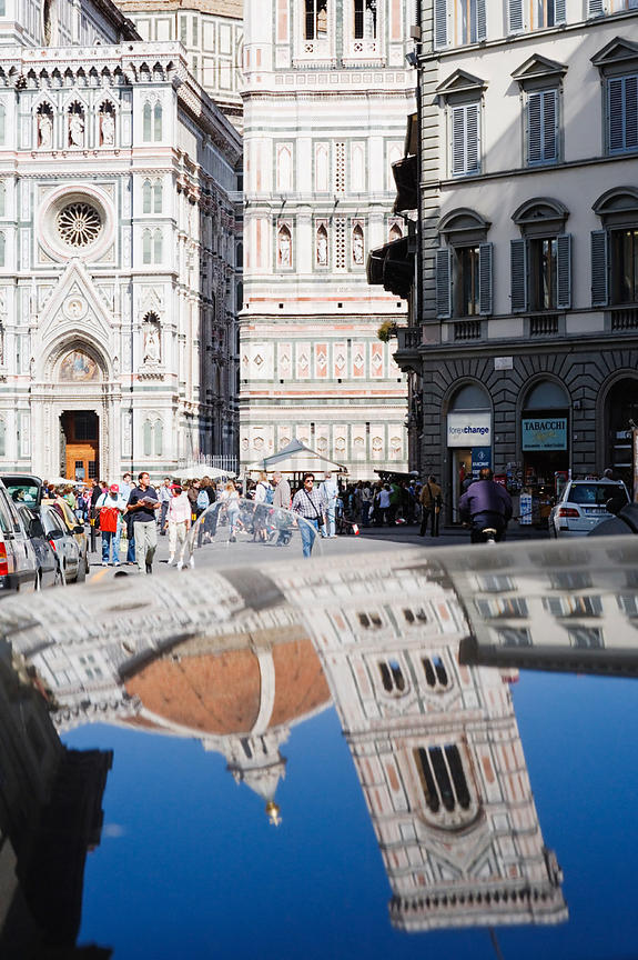 Reflection of the Duomo and the Campanile in the roof of  a car