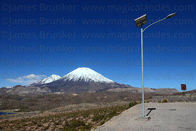 Solar powered street light next to Highway 11 , Payachatas volcanos in background , Lauca National Park , Region XV , Chile